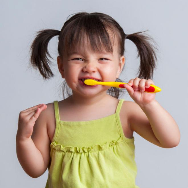girl-brushing-teeth-istock-660