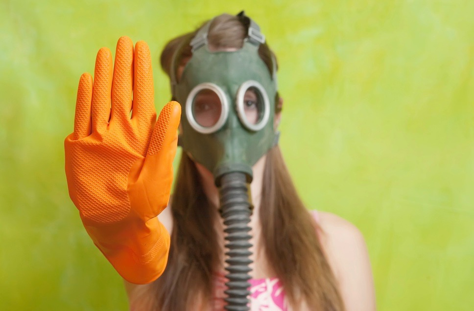 girl in gas mask pointing STOP