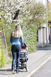 17717989-woman-with-a-pram-on-spring-walk-stock-photo
